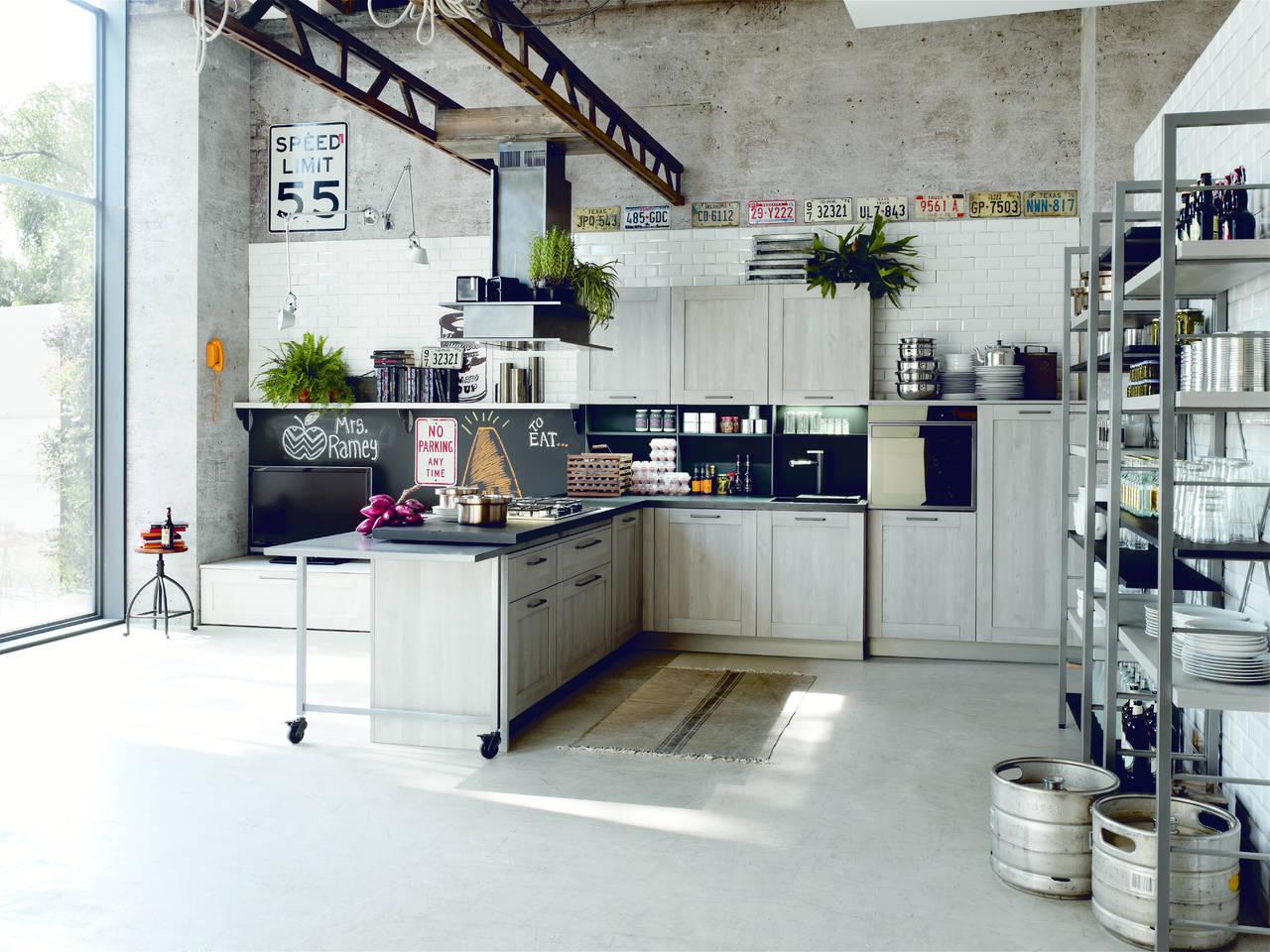 Atmosfere industriali per la cucina urbana ambiente cucina - Cucina city stosa ...