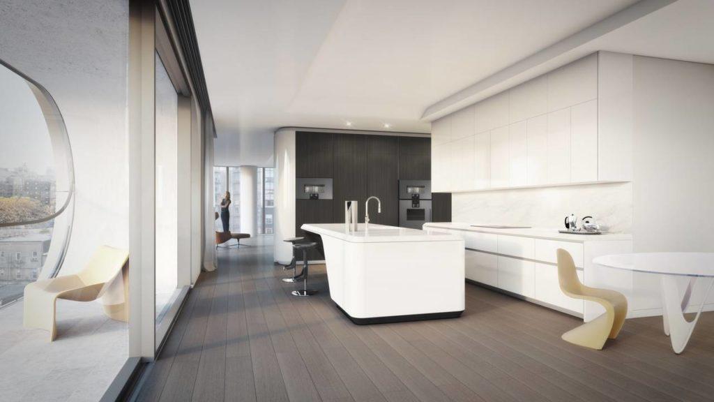 L'interno di un appartamento del bulding newyorkese520 West 28th con l'isola cucina firmata Zaha Hadid e realizzata custom da Boffi inDuPont™ Corian® bianco