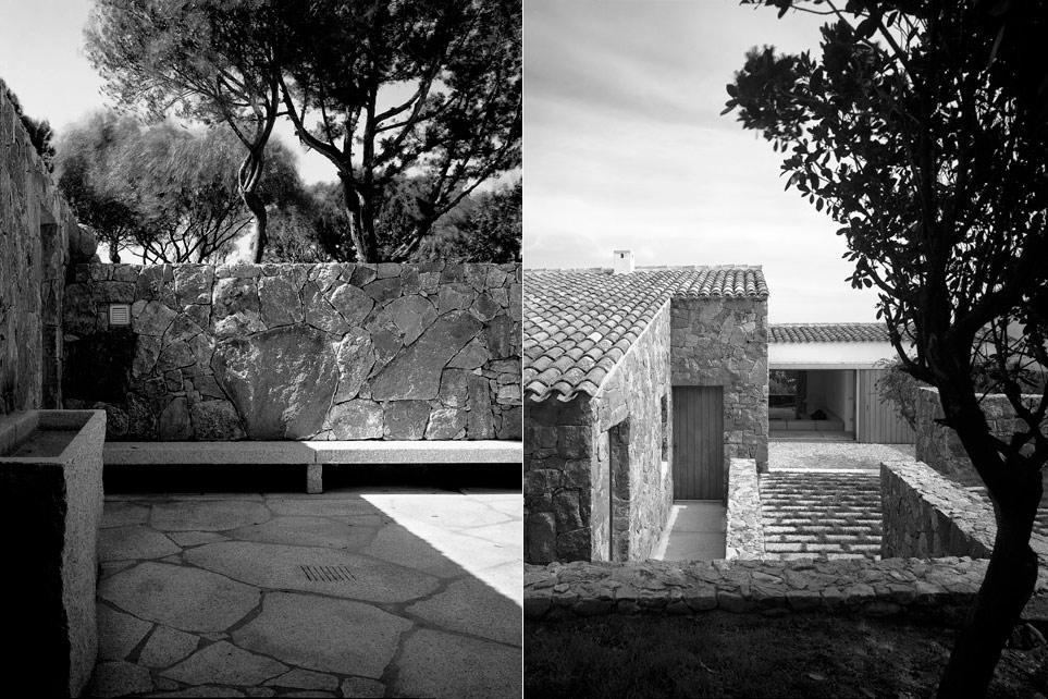 Case Di Pietra Sardegna : Casa in pietra circondato da erba e rocce con la vista dell oceano
